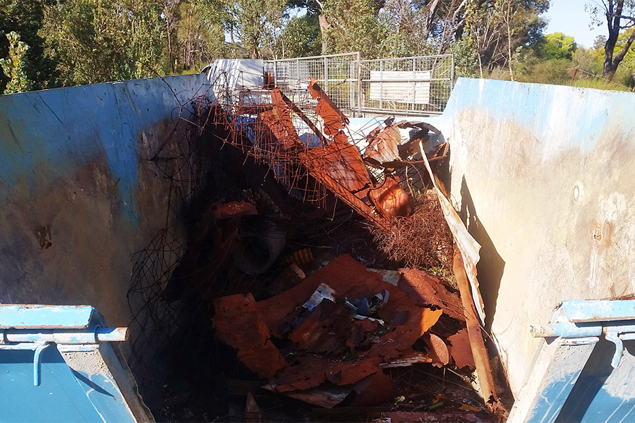 Removing illegally dumped waste from bushland in Perth